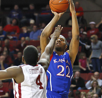 Marcus Morris (23 points, nine rebounds) manages to get this shot up over Oklahoma's Andrew Fitzgerald.  (AP)