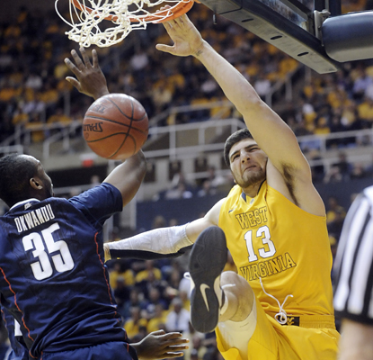 West Virginia's Deniz Kilicli dunks for two of his seven points in the Mountaineers' win over Connecticut. (AP)