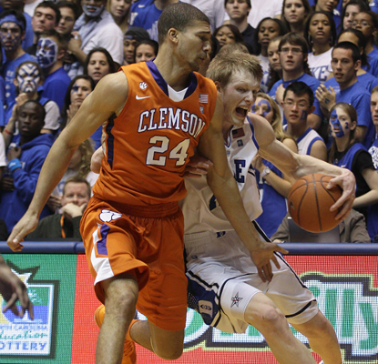 Duke's Kyle Singler drives to the basket as he helps lead the Blue Devils to a win over Clemson by contributing 18 points. (AP)