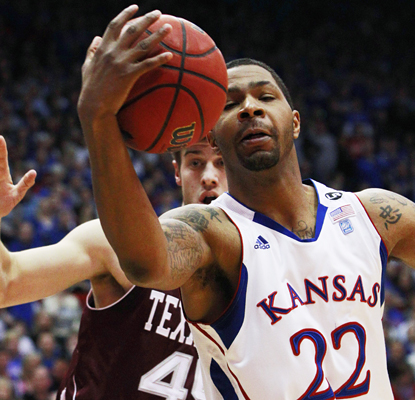 Kansas' Marcus Morris grabs one of his five rebounds and also adds 13 points as the Jayhawks beat Texas A&M. (AP)
