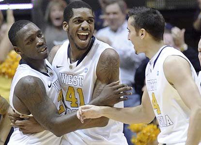 Truck Bryant (left) is the hero for the Mountaineers after hitting two game-winning free throws with 1 second  in regulation. (AP)