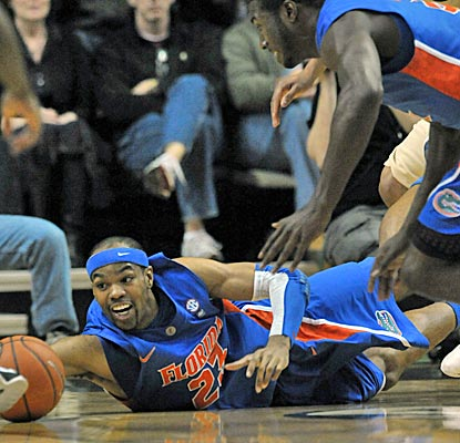 Gators forward Alex Tyus reaches for a loose ball and finishes with 13 points and 10 rebounds in the Gators' win.  (US Presswire)