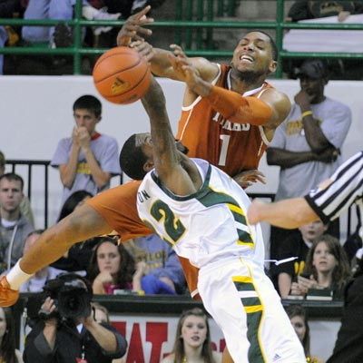 The Longhorns' Gary Johnson fights for a loose ball with Baylor's A.J. Walton during the first half in Waco. (AP)