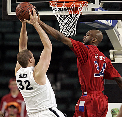 Dayton's Devin Searcy blocks a shot on Xavier's Kenny Frease as the Flyers get the upset. (AP)