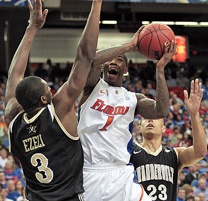 Florida's Kenny Boynton (game-high 24 points) takes it right at Vanderbilt big man Festus Ezeli.  (AP)