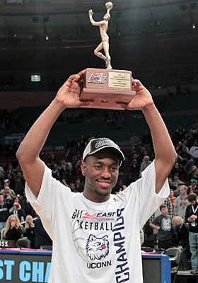 Kemba Walker holds up the Big East tournament's Most Outstanding Player award after UConn's win. (US Presswire)