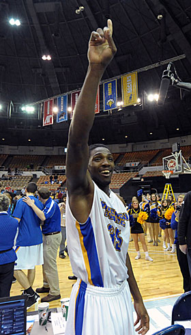 A moment please, Louisville, Morehead State's Kenneth Faried would like a word. (US Presswire)