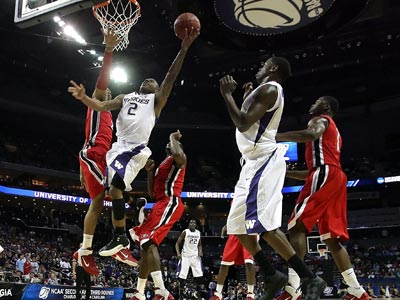 Isaiah Thomas posts 19 points, one board and seven assists while powering the Huskies to victory over Georgia.  (Getty Images)