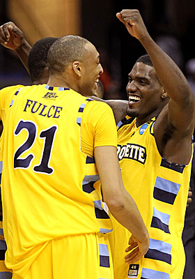 Marquette players celebrate ousting Big East rival and No. 3 seed Syracuse from the tournament. (Getty Images)