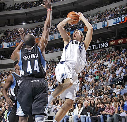 Dirk Nowitzki pulls up for a fadeaway jumper over Anthony Tolliver for two of his 30 points in the Mavericks' win. (Getty Images)