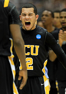 Joey Rodriguez cheers with VCU teammates after the underdog Rams' takedown of No. 1 seed Kansas. (Getty Images)