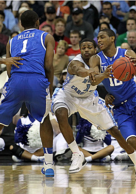 Darius Miller sets a pick for Wildcats teammate Brandon Knight during Kentucky's defeat of UNC. (Getty Images)