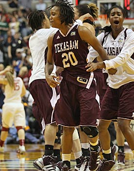 The Aggies celebrate after knocking off a No. 1 seed for the second straight game after beating Baylor. (Getty Images)
