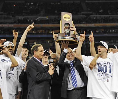 Jim Calhoun raises his third national championship trophy, his first since 2004.  (US Presswire)