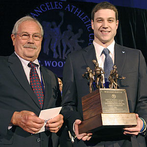 John Wooden's son, Jim, presents Jimmer Fredette with the Men's John Wooden Award. (AP)