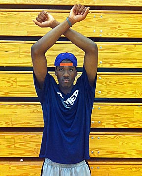 Jalen Reynolds strikes his X for Xavier pose.