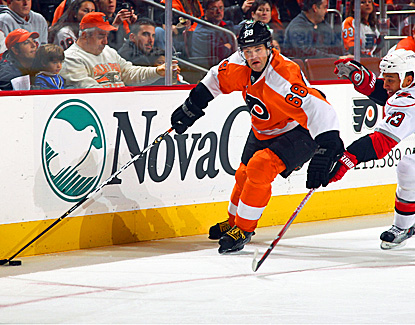 Jaromir Jagr scores the first of his two goals of the night against former Flyers goalie Brian Boucher.  (Getty Images)