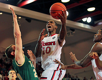 St. John's Nurideen Lindsey drives to the net past William & Mary's Quinn McDowell for two of his 19 points. (US Presswire)