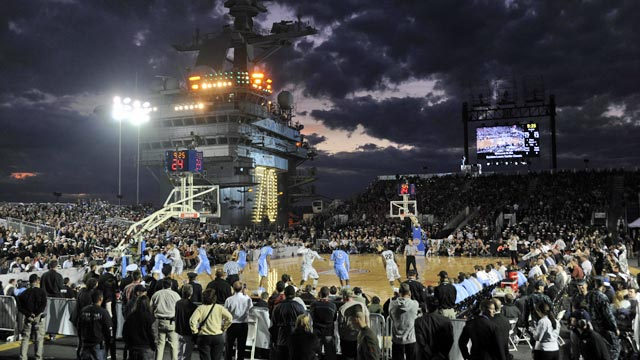 Roy Williams and Tom Izzo said the game played before 8,111 people worked out well. (US Presswire)