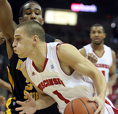 Ben Brust drives to the hoops on his way to 14 points as Wisconsin throttles Kennesaw State. (US Presswire)