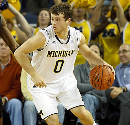 Zack Novak adds layups to help Michigan get a large lead early in the game to crush Towson. (US Presswire)