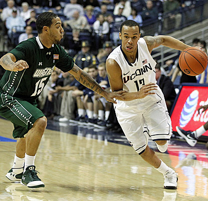 Shabazz Napier scores 21 points to help Connecticut get past pesky Wagner.  (US Presswire)