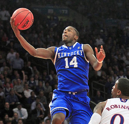 Every starter in the Wildcats' lineup finishes in double figures, including Michael Kidd-Gilchrist, who scores 12 points. (AP)