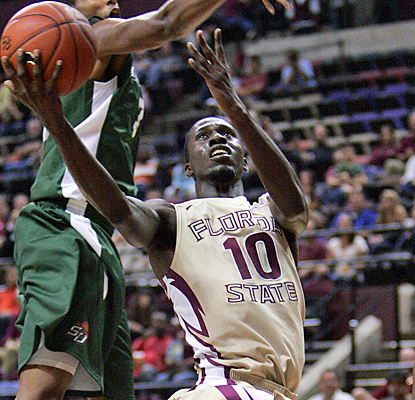 Florida State's Okaro White splits through Stetson's defense for 18 points to lead all scorers. (AP)