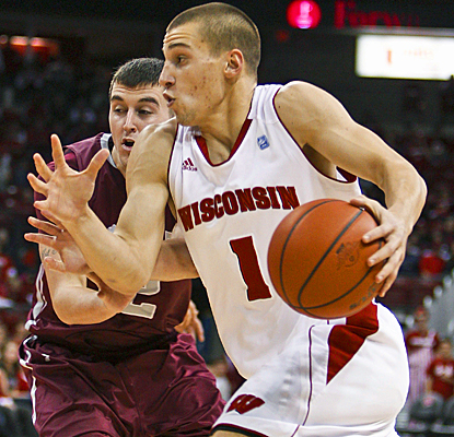 No. 14 Wisconsin's Ben Brust drives past Colgate to score a career-high 17 points to lead all scorers.  (AP)