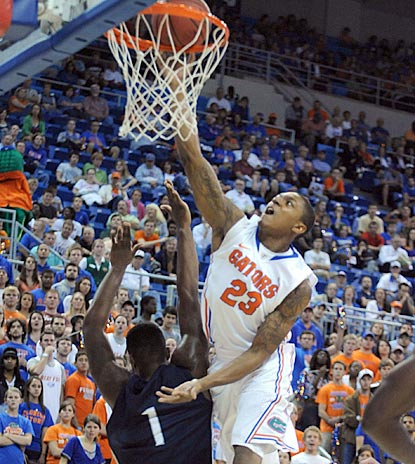 Florida's Bradley Beal goes up and over North Florida's Travis Wallace for a basket during the first half.  (AP)