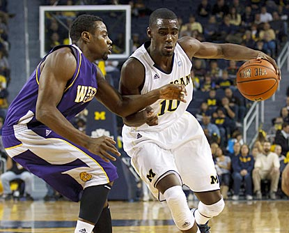 Tommie Tyler (left) and the Leathernecks keep up with Tim Hardaway Jr. and the Wolverines for most of the game.  (US Presswire)