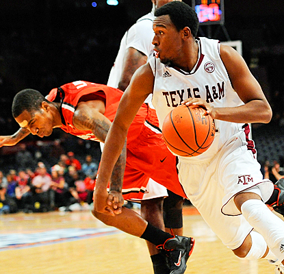Texas A&M's Elston Turner drives to the basket for two of his eight points against St. John's.  (Getty Images)