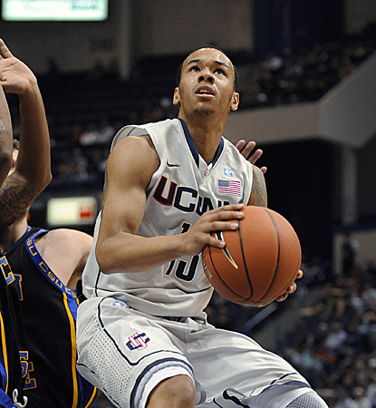 Shabazz Napier records 22 points, 13 dimes and 12 rebounds for the ninth triple-double in UConn history. (AP)