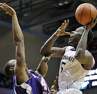 Justin Jackson (right) and the Cincinnati Bearcats have no problem with Northwestern State. (AP)