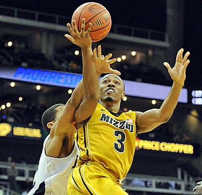 Missouri's Matt Pressey draws a foul during the Tigers' convincing win over Notre Dame. (US Presswire)