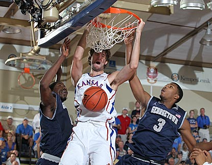 Kansas junior center Jeff Withey dunks against Georgetown forward Mikael Hopkins (3).  (US Presswire)
