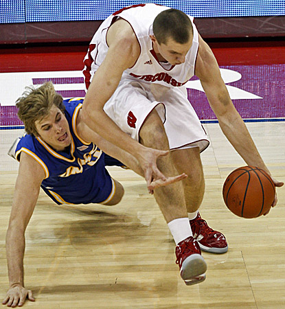 Wisconsin's Jared Berggren (right) earns a career-high 21 points against Missouri-Kansas City. (AP)