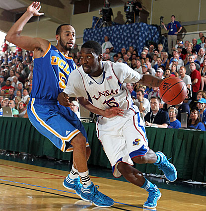The Kansas Jayhawks' Elijah Johnson scores 23 points to help beat the UCLA Bruins in the semifinals of the Maui Invitational. (US Presswire)