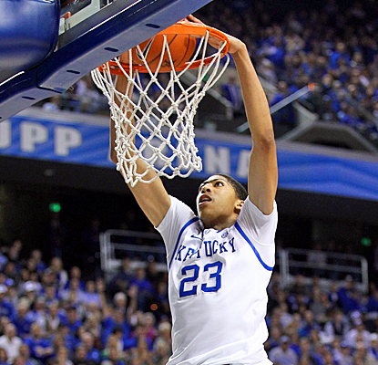 Kentucky's Anthony Davis slams home two of his 12 points against Radford. He also grabs six rebounds in the win. (Getty Images)