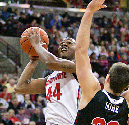 Ohio State's William Buford fights through VMI's defense for 23 points and six assists. (AP)