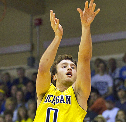 Michigan's Zach Novak scores on a 3-pointer en route to a career-high 22 points against UCLA. (AP)