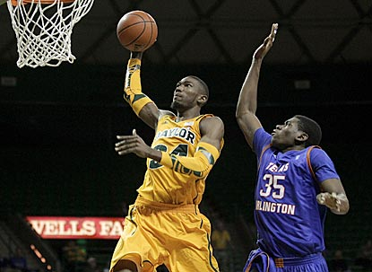 Bears forward Cory Jefferson (34) drives to the basket past Mavericks forward Brandon Edwards in the second half.  (AP)