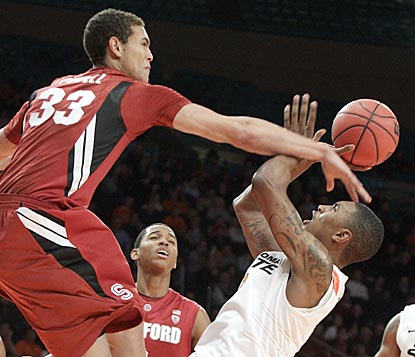 Stanford forward Dwight Powell rejects Oklahoma State's LeBryan Nash's shot during the second half.  (AP)