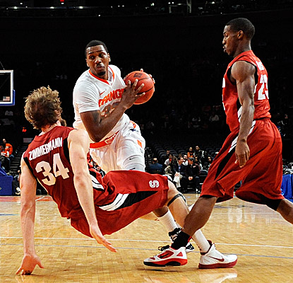 Syracuse's Kris Joseph battles through Cardinal defenders on his way to a game-high 18 points and an MVP crown. (Getty Images)