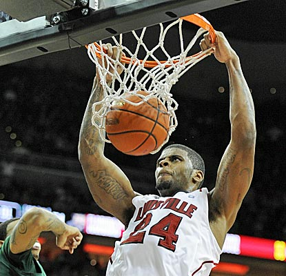 Louisville forward Shane Behanan scores 11 points, including this dunk, against Ohio. (US Presswire)