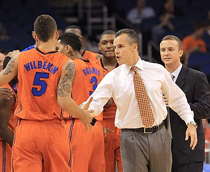Billy Donovan encourages his team during a key first-half run that helps makes him the youngest active member of the 400 Club.  (US Presswire)