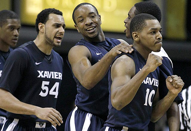 Andre Walker (54), Dezmine Wells and Mark Lyons (10) celebrate what could be a watershed victory for XU. (AP)