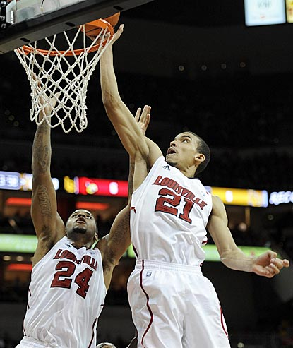 Louisville's Jared Swopshire (21) beats teammate Chane Behanan to the rim for a tip-in in the second half.  (US Presswire)