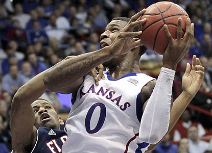 The Jayhawks lean on Thomas Robinson, who finishes with 19 points and 17 rebounds -- his sixth straight double-double. (AP)