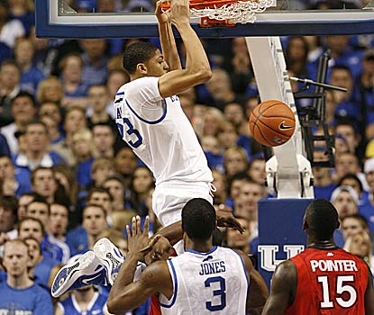 Anthony Davis, throwing down two of his 15 points, accounts for eight of UK's school-record 18 blocks to go with his 15 boards. (US Presswire)